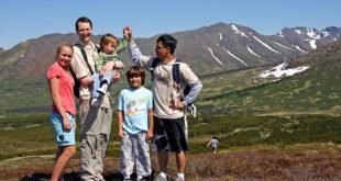 father and children walking and hiking