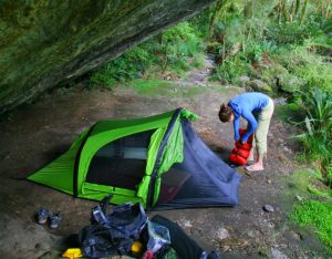 Backcountry hiking tent under cliff