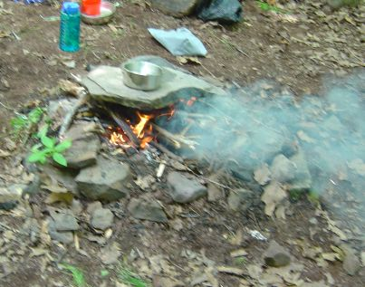 backcountry campfire with fire ring