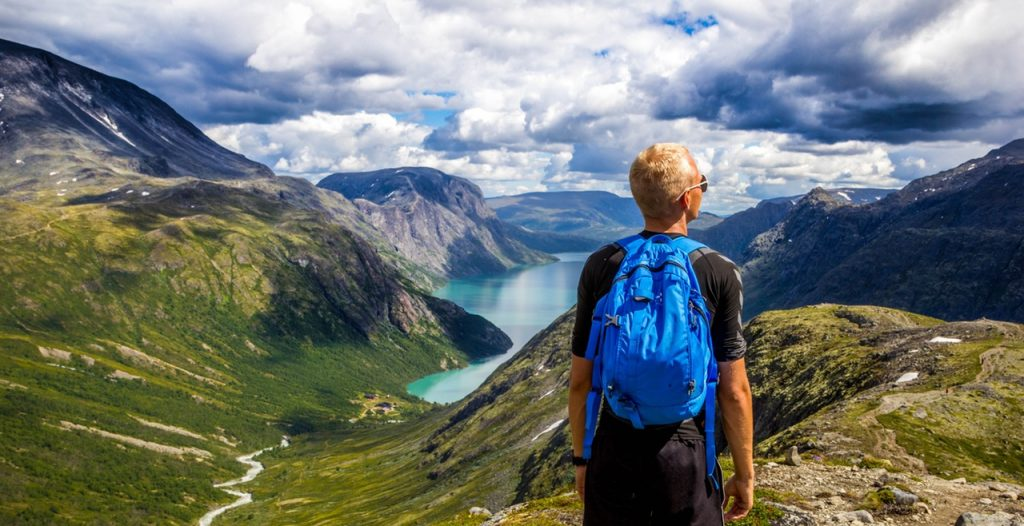 Norway boy hiking in beautiful mountains